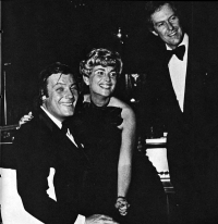 Clover Ball 1977 guests pose with society bandleader Peter Duchin