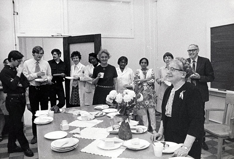 Valentina Suntzeff (front, right) celebrates her 80th birthday with coworkers.