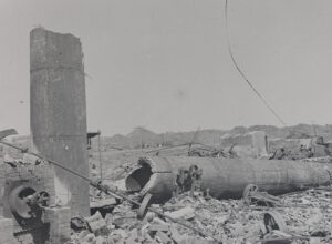 The remains of a toppled cylindrical structure surrounded by debris in all directions.